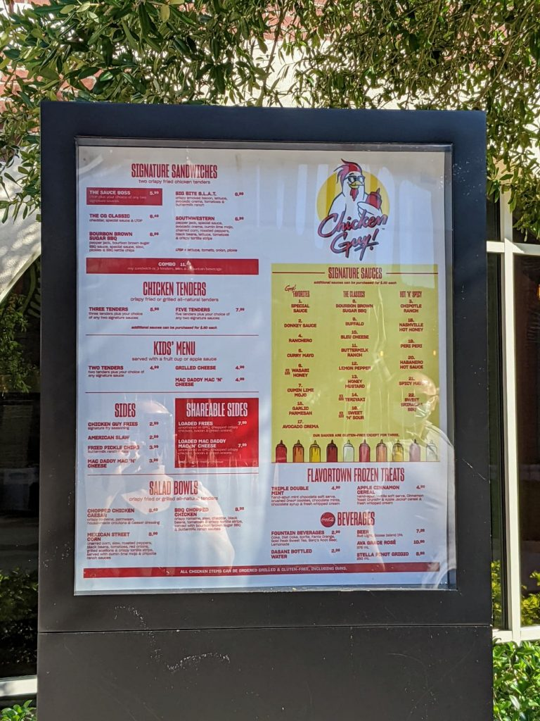 The drive through menu of a chicken tender restaurant featuring red and yellow graphics.