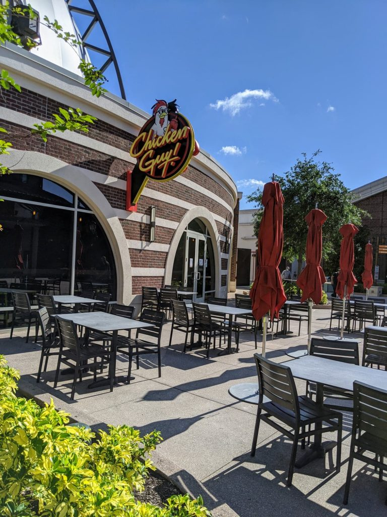 Outdoor patio restaurant seating area for Chicken Guy! in Disney Springs.