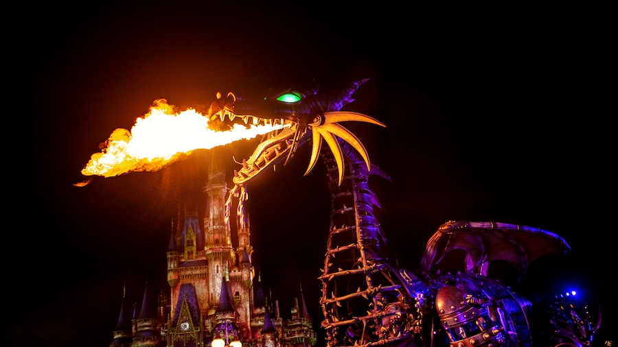 a fire breathing maleficent at a Disney Parade